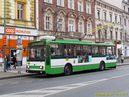Škoda 14 TrM ev.č. 450 opatřená bočními reklamami odbavuje v zastávce Mrakodrap. - 17.4.2015